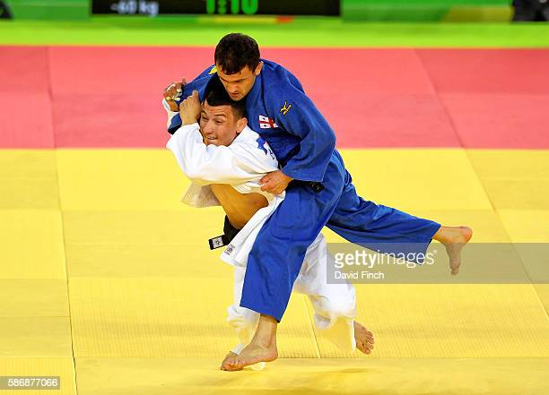 Diyorbek Urozboev of Uzbekistan attacks Amiran Papinashvili of Georgia to win the under 60kg bronze medal during day 1 of the 2016 Rio Olympic Judo...