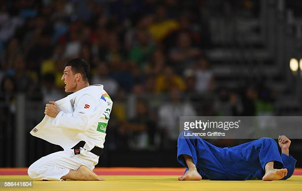 Diyorbek Urozboev of Uzbekistan celebrates after defeating Amiran Papinashvili of Georgia in the Men's -60 kg Bronze Medal B contest on Day 1 of the...