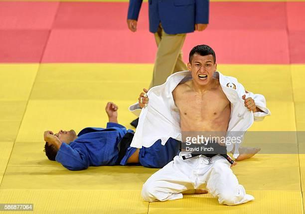 Diyorbek Urozboev of Uzbekistan celebrates defeating Amiran Papinashvili of Georgia for the under 60kg bronze medal during day 1 of the 2016 Rio...