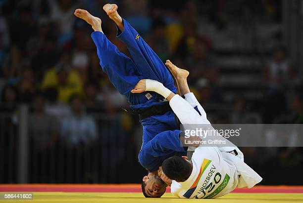 Diyorbek Urozboev of Uzbekistan competes against Amiran Papinashvili of Georgia in the Men's 60 kg Bronze Medal B contest on Day 1 of the Rio 2016...