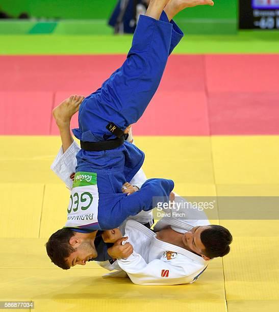 Diyorbek Urozboev of Uzbekistan defeated Amiran Papinashvili of Georgia to win the under 60kg bronze medal during day 1 of the 2016 Rio Olympic Judo...
