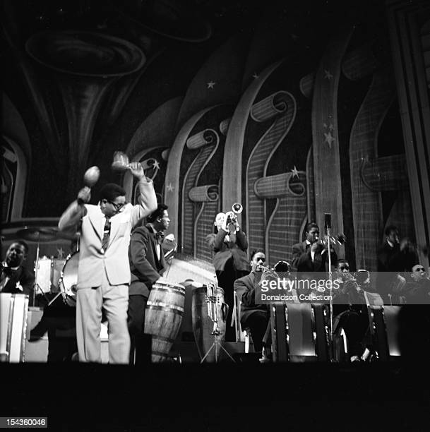 Dizzy Gillespie plays the maracas as he conducts his BeBop Orchestra at the Strand Theater on Broadway on December 10 1948 in New York New York