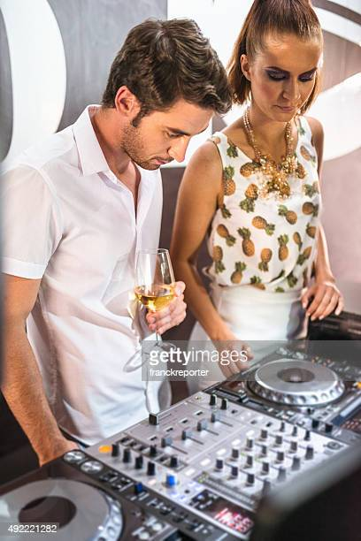 dj at the console in a disco club
