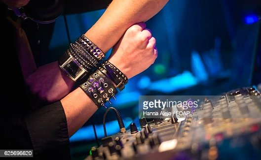 dj hands on top of record player in nightclub stock photo getty images
