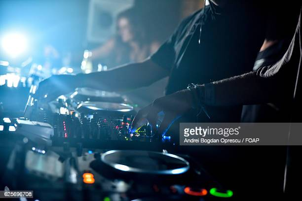 Dj playing music at nightclub