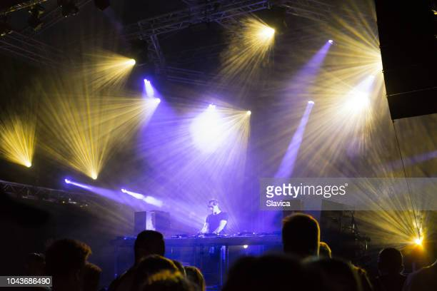 dj playing techno music - filter band stock photos and pictures