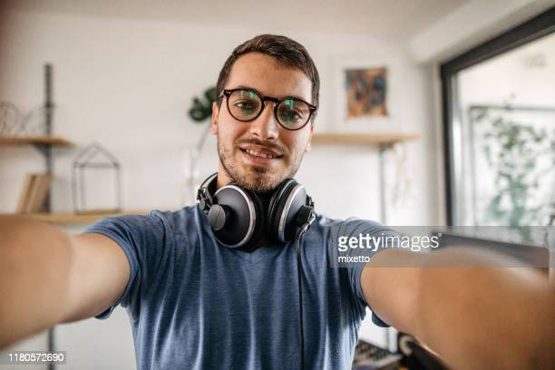 dj taking selfie at home recording studio - selfie stock pictures, royalty-free photos & images