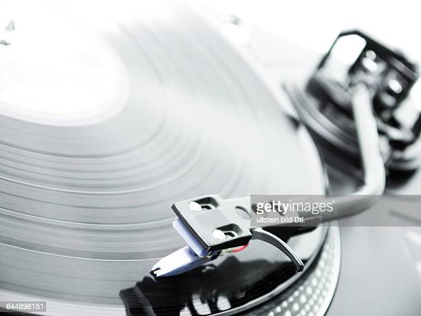 dj turntable plays music from a record