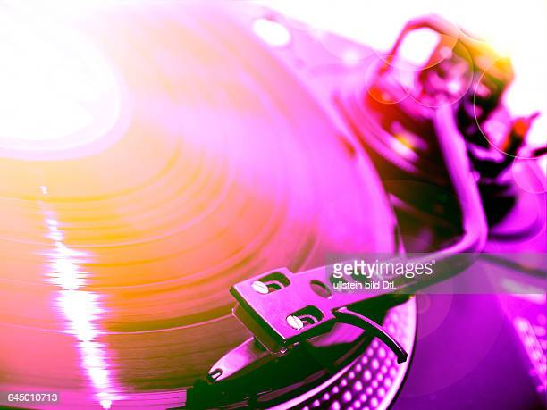 dj turntable with violet and orange light