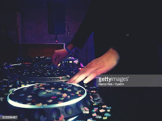 Dj Using Mixing Desk At Nightclub