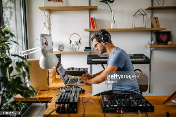 dj working at home recording studio - post-production stock pictures, royalty-free photos & images