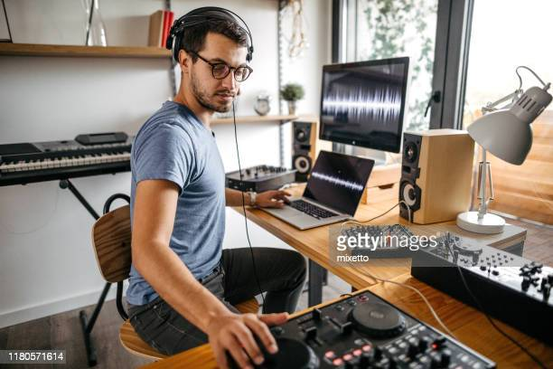 dj working on digital mixing control at home recording studio - post-production stock pictures, royalty-free photos & images