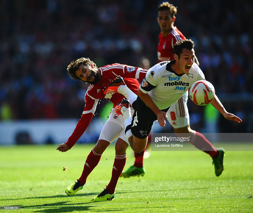 Djamal Abdoun of Nottingham Forest battles with Adam Smith of Derby Couunty during the Sky Bet Championship match between Nottingham Forest and Derby County at City Ground on September 28, 2013 in Nottingham, England,