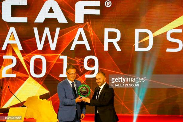 Djamel Belmadi Algerian coach of the Algerian national team is presented with the Men's Coach of the Year trophy during the 2019 CAF Awards in the...