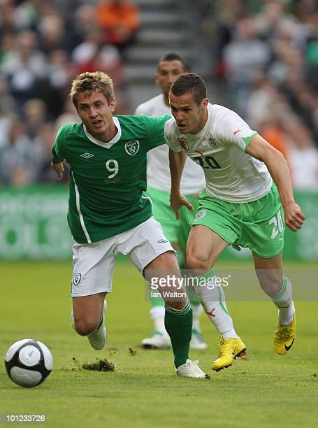 Djamel Masbah of Algeria tries to tackle Kevin Doyle of Republic of Ireland during the International Friendly match between Republic of Ireland and...