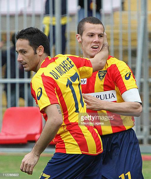 Djamel Mesbah of Lecce celebrates after scoring the 11 equaliser with teammate David Di Michele during the Serie A match between Lecce and Cagliari...