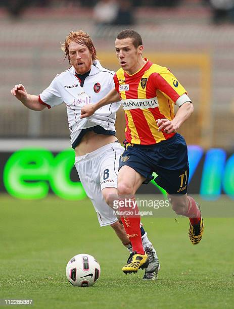 Djamel Mesbah of Lecce is challenged by Davide Biondini of Cagliari during the Serie A match between Lecce and Cagliari Calcio at Stadio Via del Mare...