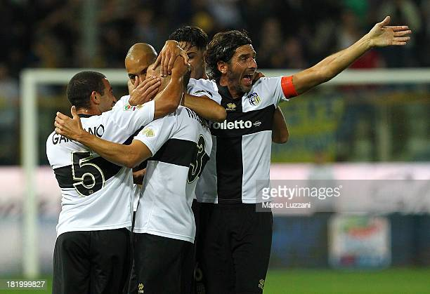 Djamel Mesbah of Parma FC celebrates with his teammates after scoring the opening goal during the Serie A match between Parma FC and Atalanta BC at...