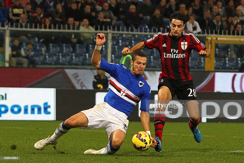 Djamel Mesbah of UC Sampdoria handballs under pressure from Giacomo Bonaventura of AC Milan, to concede a penalty during the Serie A match between UC Sampdoria and AC Milan at Stadio Luigi Ferraris on November 8, 2014 in Genoa, Italy.