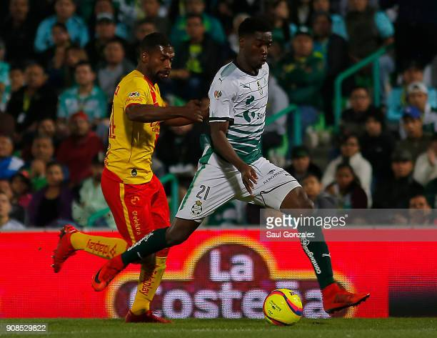 Djaniny Tavares of Santos and Gabriel Achilier of Morelia fight for the ball during the 3rd round match between Santos Laguna and Morelia as part of...