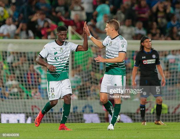 Djaniny Tavares of Santos celebrates with teammate Julio Furch after scoring the second goal of his team during the 9th round match between Santos...
