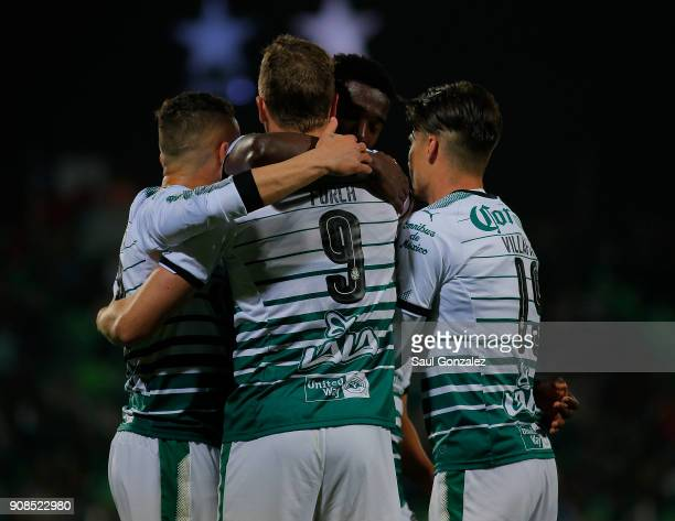 Djaniny Tavares of Santos celebrates with teammates after scoring the first goal of his team during the 3rd round match between Santos Laguna and...