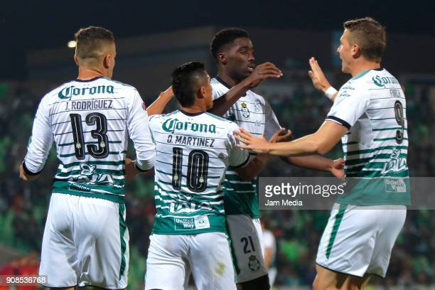Djaniny Tavares of Santos celebrates with teammates after scoring the first goal of his team during the third round match between Santos Laguna and...