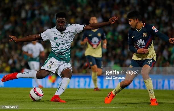 Djaniny Tavares of Santos fights for the ball with Carlos Vargas of America during the 17th round match between Santos Laguna and America as part of...