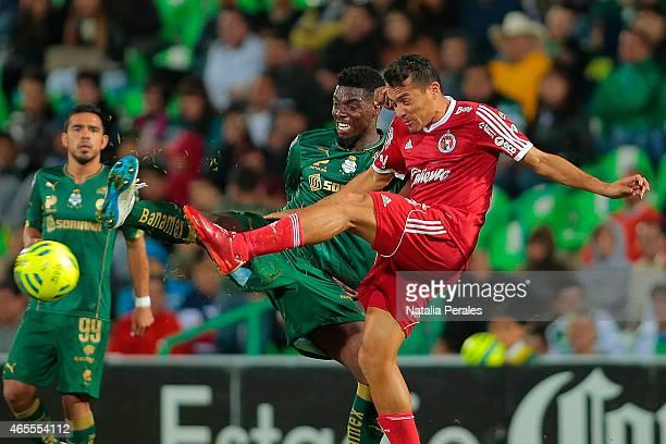 Djaniny Tavares of Santos fights for the ball with Juan Arango of Tijuana during a match between Santos Laguna and Tijuana as part of 9th round...
