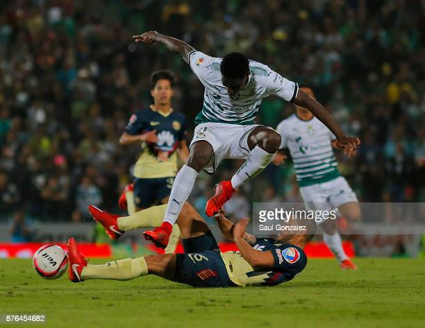 Djaniny Tavares of Santos fights for the ball with Miguel Samudio of America during the 17th round match between Santos Laguna and America as part of...