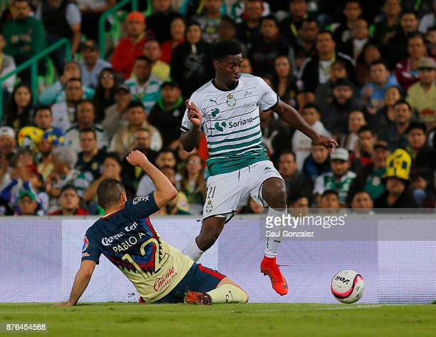 Djaniny Tavares of Santos fights for the ball with Pablo Aguilar of America during the 17th round match between Santos Laguna and America as part of...
