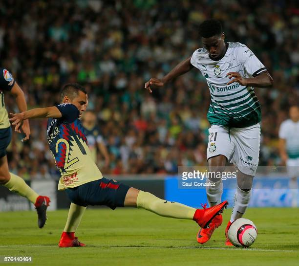 Djaniny Tavares of Santos fights for the ball with Paul Aguilar of America during the 17th round match between Santos Laguna and America as part of...