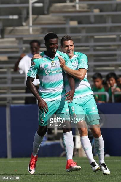 Djaniny Tavares of Santos Laguna celebrates with teammate Julio Furch after scoring the first goal of his team during the friendly match between...