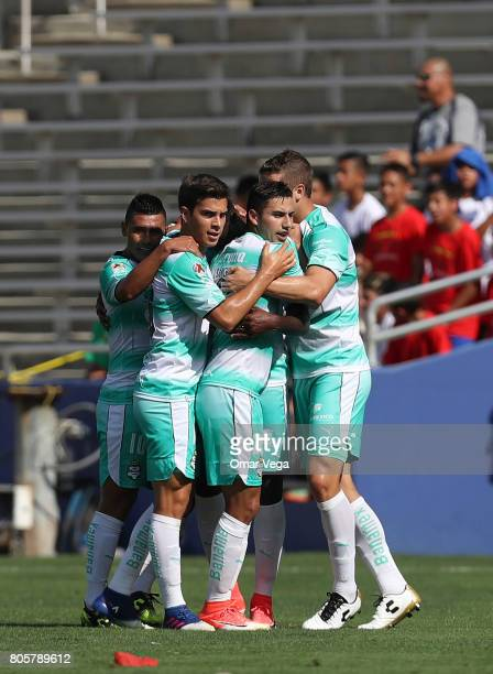 Djaniny Tavares of Santos Laguna celebrates with teammates after scoring the first goal of his team during the friendly match between Chivas and...