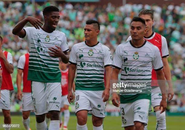 Djaniny Tavares Osvaldo Martinez and Jose Vazquez of Santos leave the field during the quarter finals second leg match between Santos Laguna and...