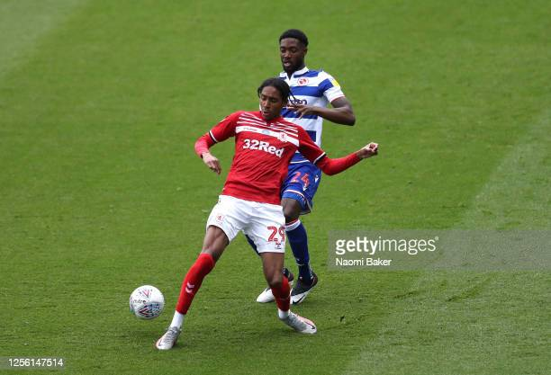 Djed Spence of Middlesbrough is challenged by Tyler Blackett of Reading during the Sky Bet Championship match between Reading and Middlesbrough at...