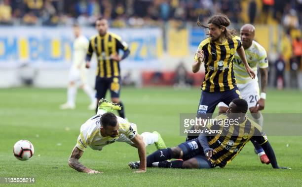Djedje of MKE Ankaragucu in action against Mehmet Topal of Fenerbahce during Turkish Super Lig soccer match between MKE Ankaragucu and Fenerbahce at...