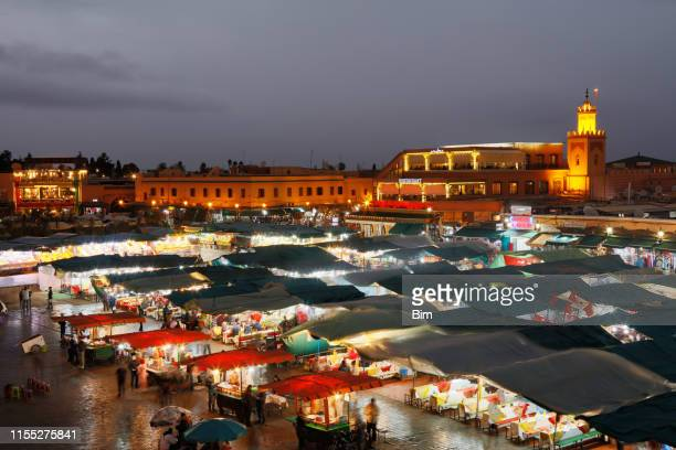 djemaa el fna square in marrakesh at night, morocco - north africa stock photos and pictures