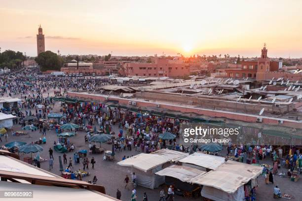 djemma el fna square at sunset - djemma el fna square stock photos and pictures