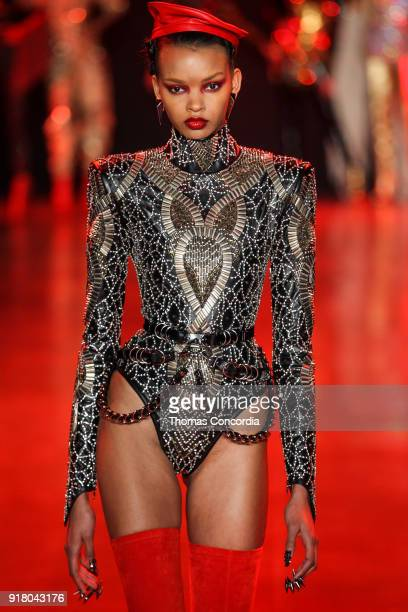 Djenice Duarte walks the runway wearing The Blonds Fall 2018 Collection with makeup by Kabuki Magic and the MAC Pro team hair by Kien Hoang and Oribe...