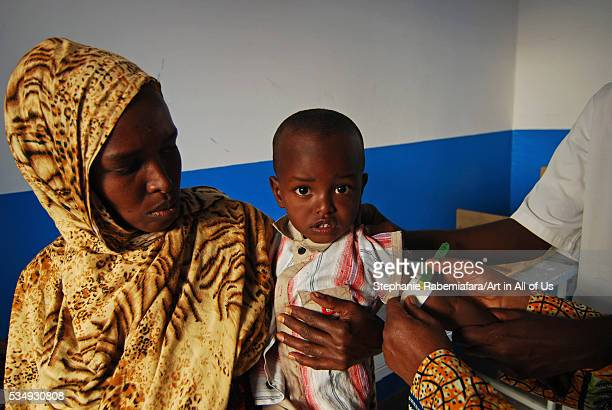Djibouti Ali Sabieh doctor measuring arm circumference of baby