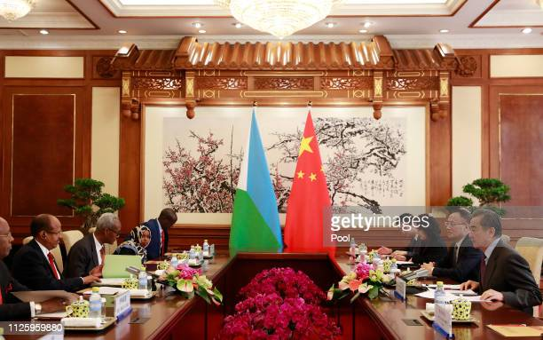 Djibouti Foreign Minister Mahamoud Ali Youssouf and his Chinese counterpart Wang Yi during their meeting during their meeting at the Diaoyutai State...