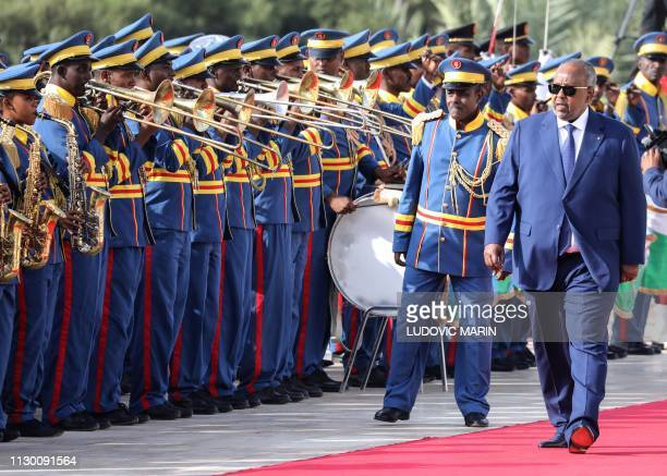 Djibouti president Ismail Omar Guelleh walks during an official military welcome ceremony for the French President at the presidential palace in...