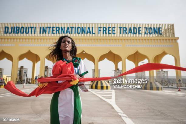 A Djiboutian woman takes part in reheasals for ribbon cutting in front of the main gate of Djibouti International Free Trade Zone before an...