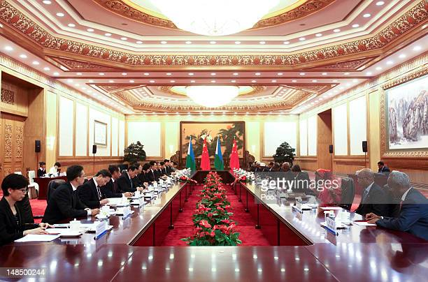 Djibouti's President Ismail Omar Guelleh and Chinese President Hu Jintao hold talks after a welcoming at the Great Hall of the People July 18 2012 in...