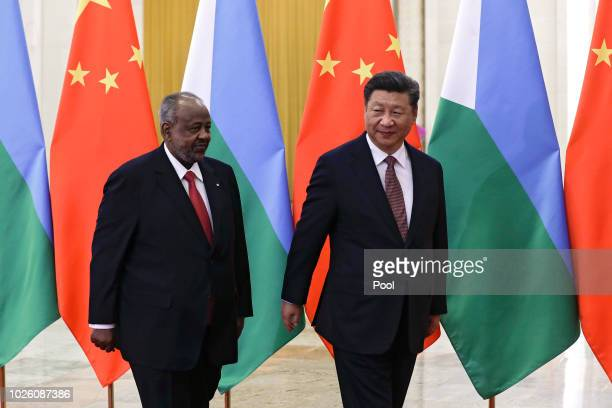 Djibouti's President Ismail Omar Guelleh and Chinese President Xi Jinping proceed to their bilateral meeting at the Great Hall of the People on...