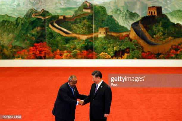 Djibouti's President Ismail Omar Guelleh left shakes hands with Chinese President Xi Jinping during the Forum on ChinaAfrica Cooperation held at the...