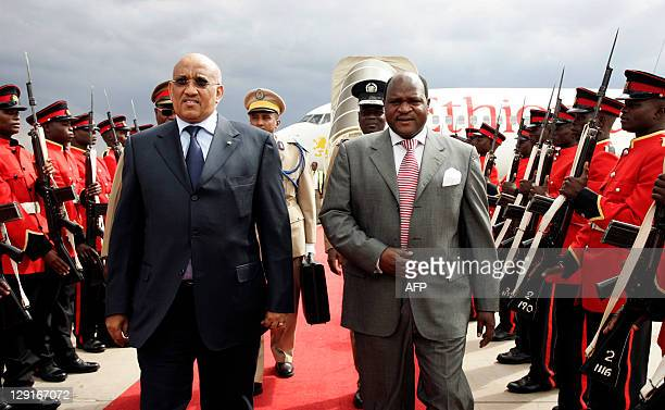Djibouti's Prime Minister Dileta Muhammed Dileta and Malawi's speaker of house for the Parliament Henry Chimunthu Banda review a guard of honour at...