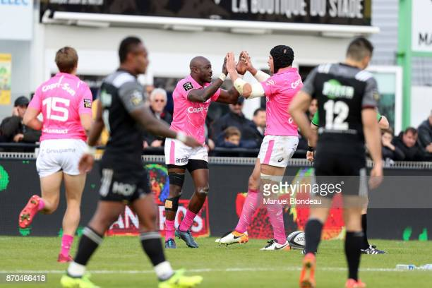 Djibril Camara of Stade Francais celebrates with Sergio Parisse after scoring a try during the French Top 14 match between Brive and Stade Francais...