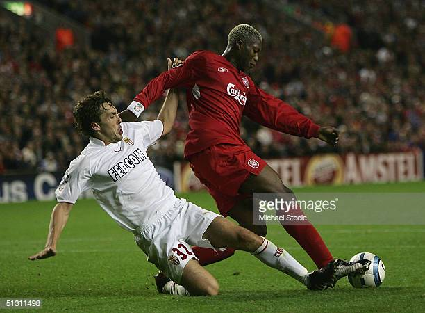 Djibril Cisse of Liverpool clashes with Gael Givet of Monaco during the UEFA Champions League Group A match between Liverpool and AS Monaco at...